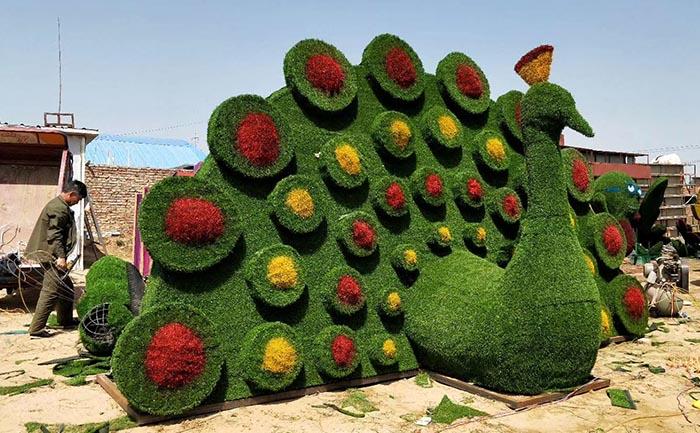 洛阳孔雀开屏仿真绿雕-仿真绿雕工艺品的制作方法